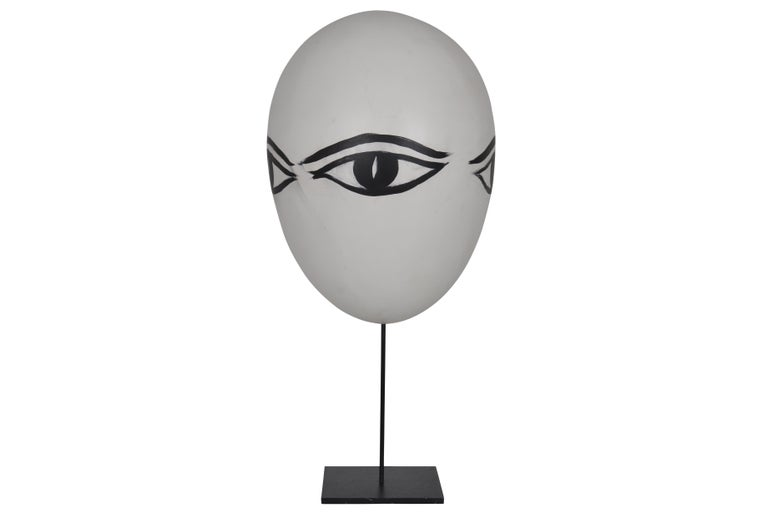 Quirky oversized egg-shaped object with 3 big painted black eyelined eyes. Signed Lorieux.
