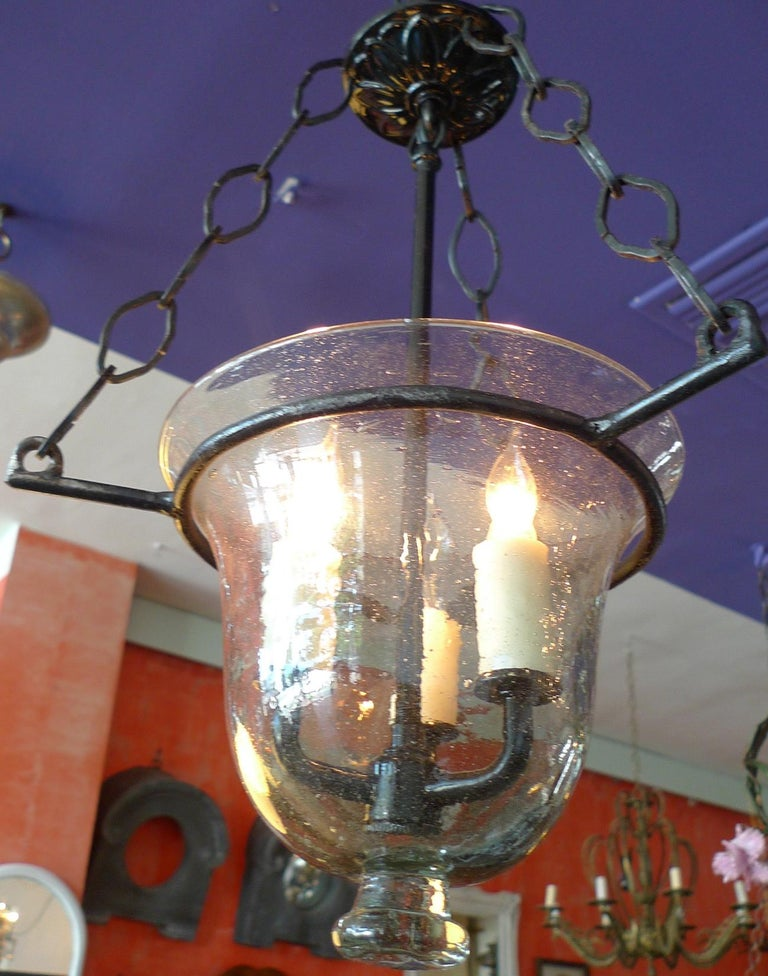 Small French vintage glass bell jar pendant with contemporary wrought iron fittings and 3 centre lights.