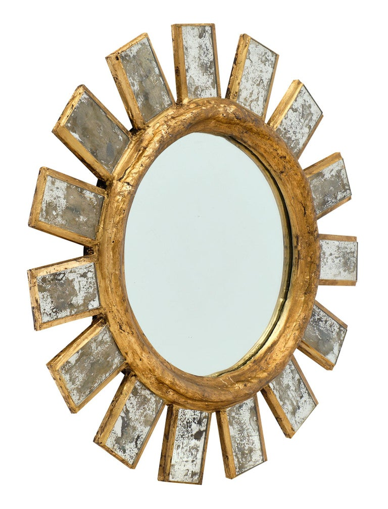 French vintage Line Vautrin style mirror with a circular wood center gold leafed and stuccoed, combined with antiqued mirrored components. We love the stylized look of this superb accessory.