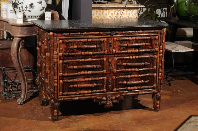 A vintage French handmade three-drawer chest from the mid-20th century, with original marble top, intricate pinecone and walnut décor. Born in France during the midcentury period, this whimsical chests-of-drawers features a rectangular top with