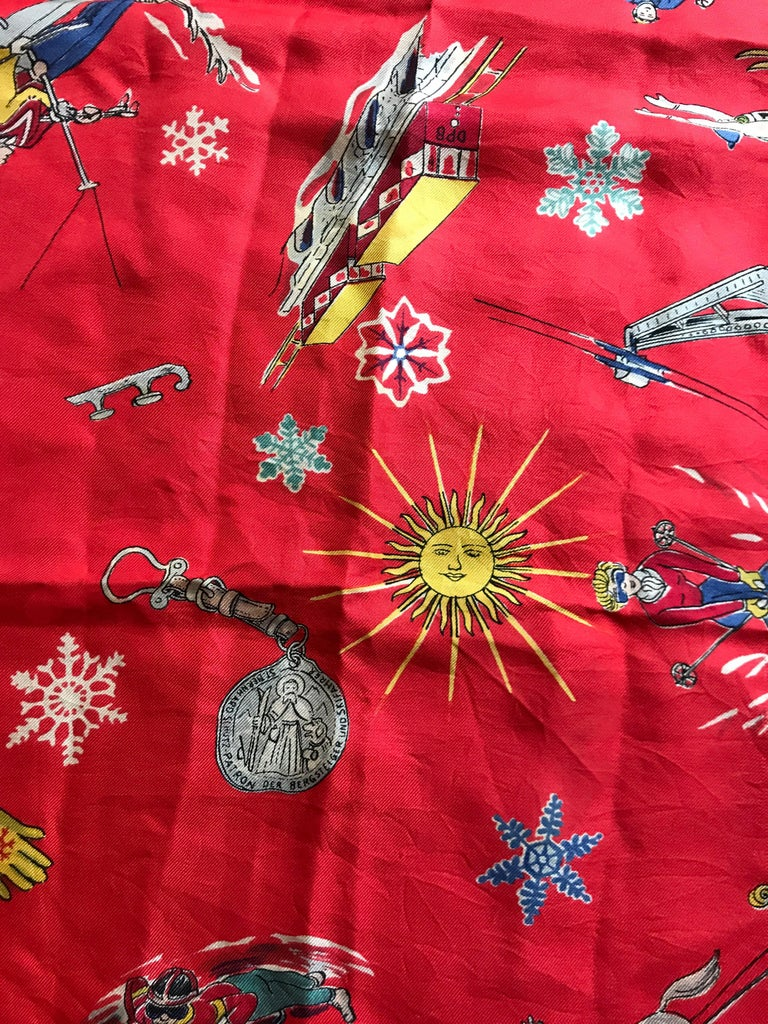 Great Holiday gift idea.. this vintage 1950 French red silk scarf is printed with examples of various winter sports. The small print makes the design especially suited to be worn folded as the pattern can still be seen. Some pin holes on the edges