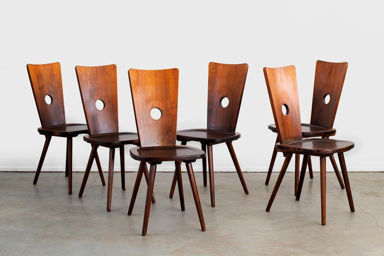 Beautiful solid walnut chairs with circle center and concave wide seat. Great lines and angled legs. Solid construction. Multiple available.