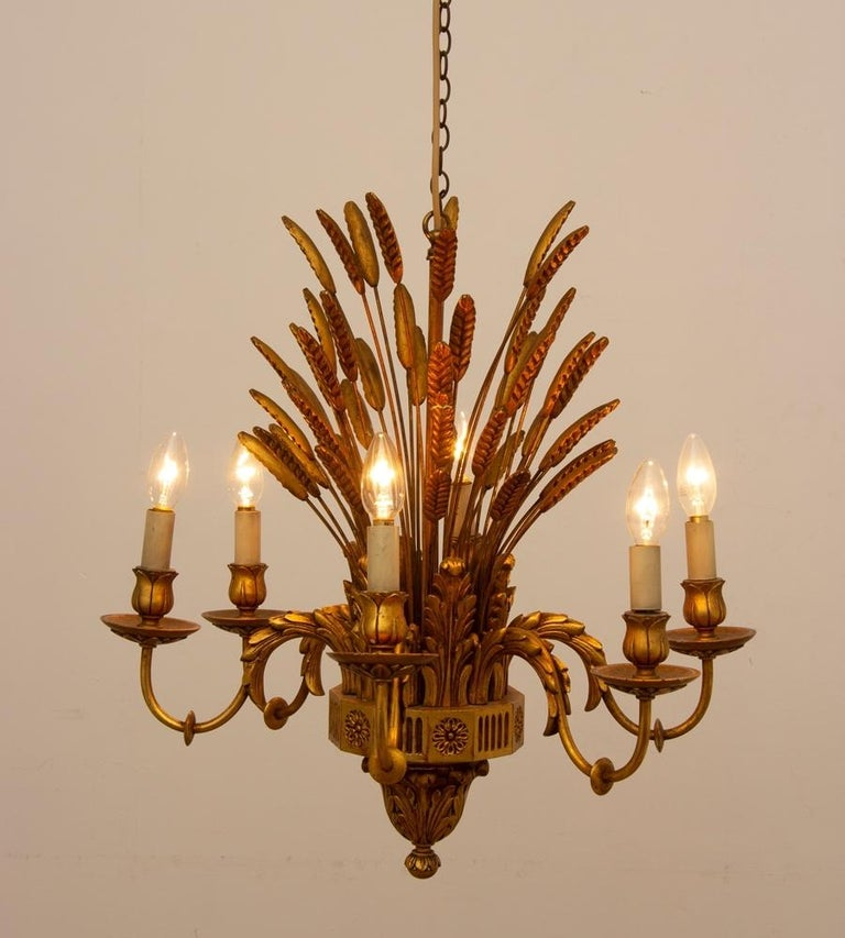 This is a lovely quality wooden example of the wheatsheaf Classic French design chandelier.
