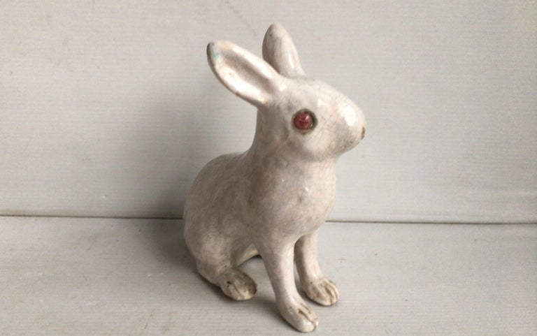 French white terracotta rabbit signed Bavent, circa 1890. (Normandy). Size: Length 6 inches on 4 inches, height 7 inches.