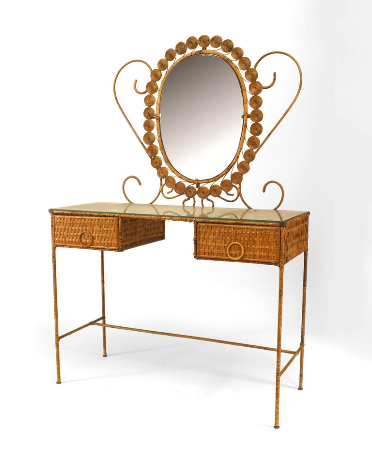 French natural wicker dressing table featuring a dramatically framed oval mirror, two drawers with circular pulls, and a glass top.