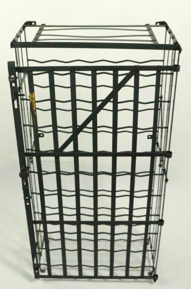 Nice early industrial style wire wine rack, storage locker by Rigidex. Clean, original condition, ready to use condition. The locker can be used freestanding, or can be wall-mounted if you prefer.