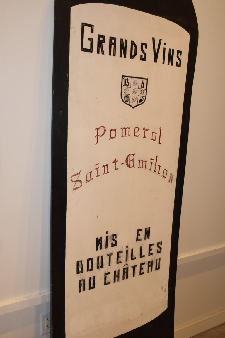 Found in France, this extra large hand painted wine bottle advertising sign is one of a kind. The sign reads Mise Du Chateau, From the Chateau; Grands Vins, Great Wines; Pomeral Saint-Emilion, types of wine sold; Mis en Bouteilles au Chateau,