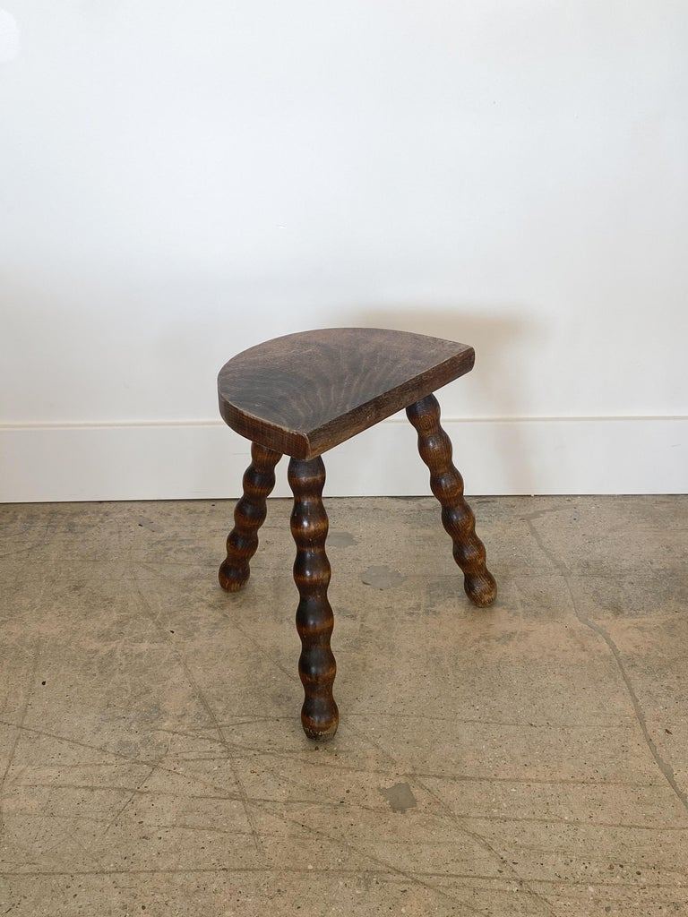 Vintage wood stool with beautiful wavy turned legs and semicircle seat from France. Original wood finish with great age markings and patina. Can be used as a small stool or as a side table.