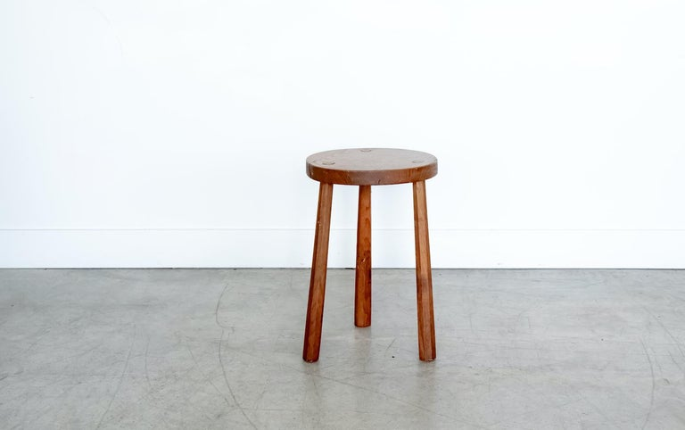 Vintage circular wood stool with tripod legs from France. Original light wood finish with great age markings and patina. Can be used as a stool or as side table next to chairs.