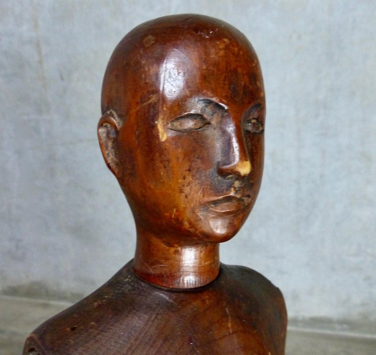 An unusual mid-sized, hand carved wooden artist's model from France, circa 1900. The model is fully articulating so it can hold a variety of poses. Handmade models from this era in France are increasingly rare — especially in this