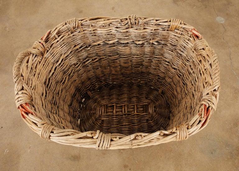 French Woven Wicker Champagne Grape Harvest Basket In Distressed Condition For Sale In Rio Vista, CA