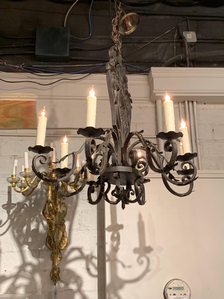 Beautiful French 8-light wrought iron chandelier. Nice heavy scroll work design on the wrought iron. Comes with a decorative chain and canopy, ready to hang.