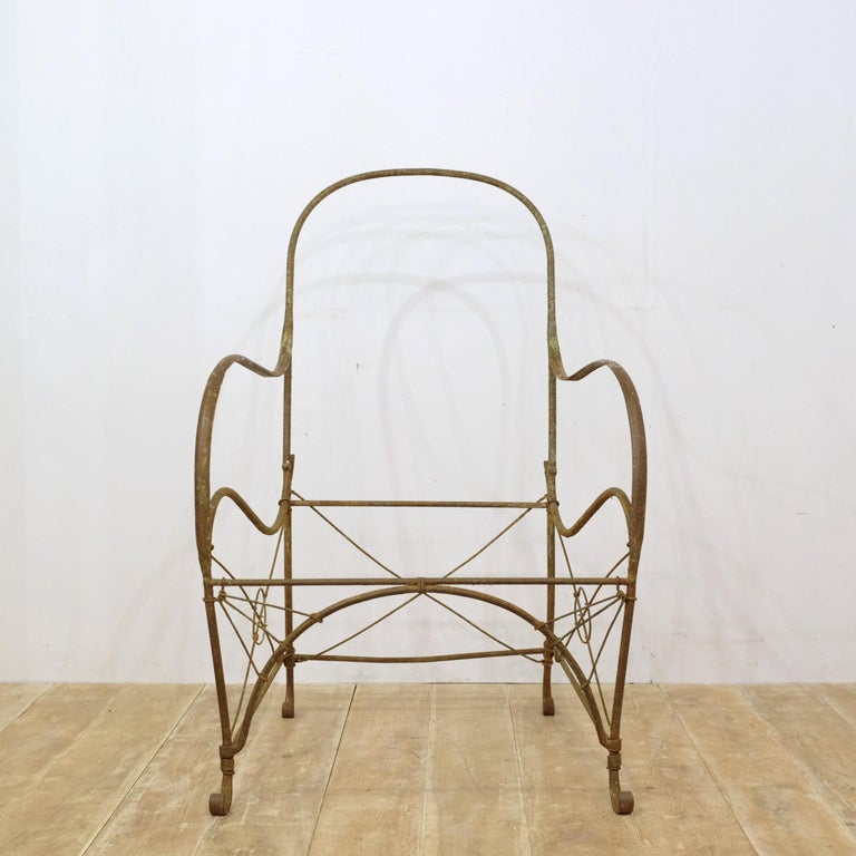 Sculptural and incredibly charming French wrought iron garden chair frame. Originally it would've had a metal mesh seat but this has rusted away, leaving the solid longevity of the iron frame. We decided to rescue the chair, despite it's lack of