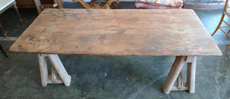 French 19th Century Stained Pinewood Coffee Table Top on Two Pinewood Sawhorses In Distressed Condition For Sale In Santa Monica, CA