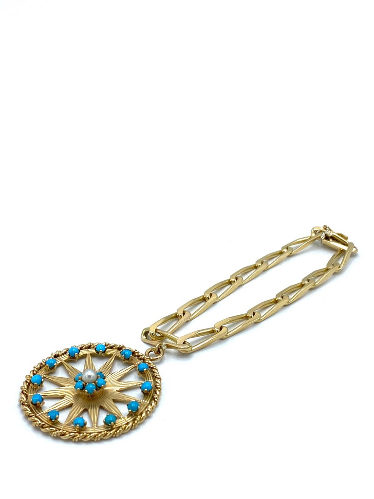 Product details:  1970s 18K yellow gold paper clip chain with box in clasp and safety, stamped with French eagle head mark. 1960s 18K yellow gold, turquoise and pearl, featuring pinwheel motif pendant, the bail is stamped with French eagle head