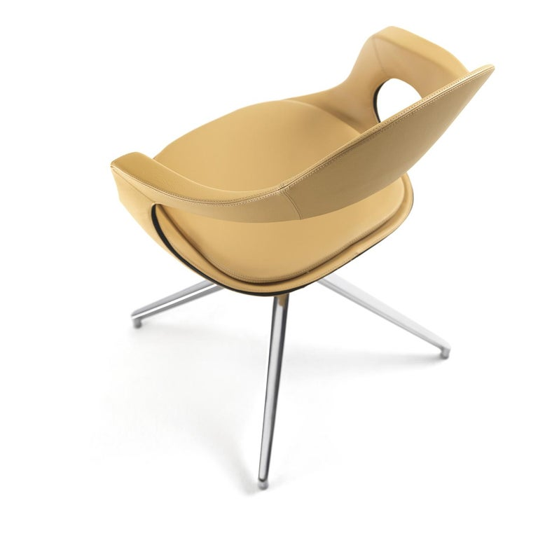 Part of Stefano Bigi's French kiss collection, this swivel chair is attractive, sophisticated and extremely comfortable. Its steel structure sits atop a chromed trestle base and is covered in lion-colored soft leather filled with polyurethane foam