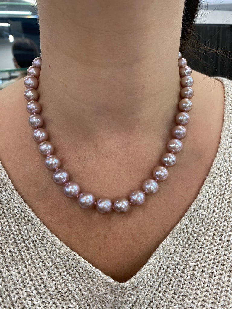 A lovely perfectly matched pearl strand necklace featuring 38 Freshwater Lavender Pearls measuring 10-12.5 mm with a high polish ball clasp in 14K White Gold.   Pearl quality: AAA Pearl Luster: AAA Excellent Nacre : Very Thick  Strand can be made to