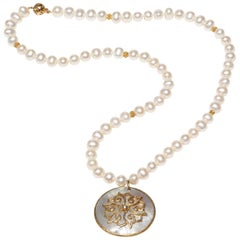 Freshwater Pearl Necklace with Lotus motif of Gold on Mother of Pearl Pedant
