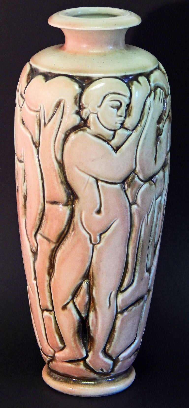 One of the most striking -- and rare -- vases ever produced by the Mougin ceramics firm in France, this vase ringed by four nude male figures clasping hands was sculpted by Gaston Goor. The artist was famous for illustrating a number of books by