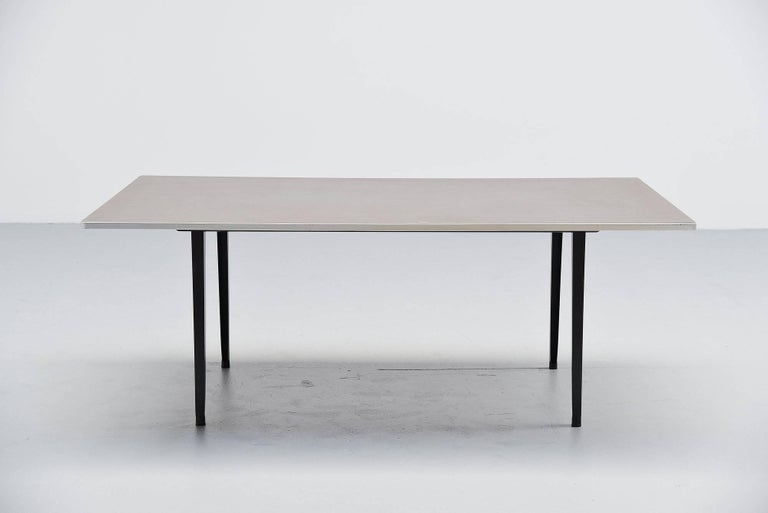 Nice and rare industrial dining or working table designed by Friso Kramer for Ahrend de Cirkel, Holland 1955. This table is the second largest version made, 200 cm long top. This has a rectangular shaped top, finished with dark grey linoleum and an