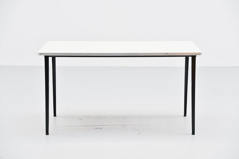 Very nice medium dining or working table designed by Friso Kramer for Ahrend de Cirkel, Holland 1955. This table has a very nice light grey formica top and a black frame, we always have several in stock in a variety of sizes and editions so please