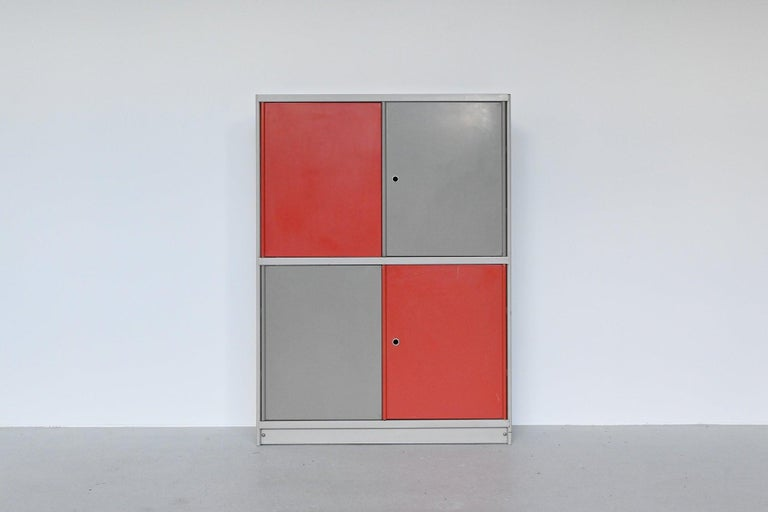 Industrial and rare Stabilux cabinet designed by Friso Kramer for Ahrend de Cirkel, The Netherlands 1960. This very nice symmetric cabinet is made of lacquered metal and has several shelves inside. There is a plenty of space behind the original red