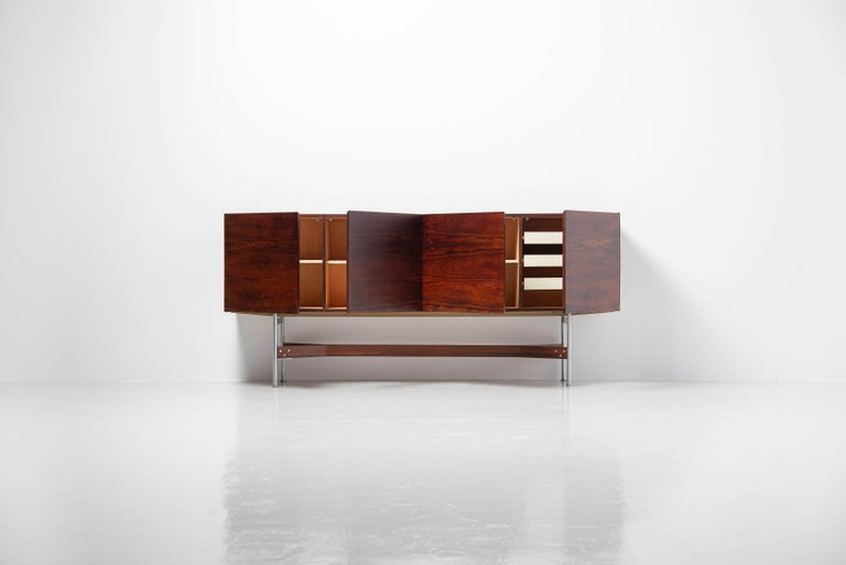 Beautiful and unique high sideboard designed by Rudolf Glatzel produced by Fristho Franeker, Holland 1962. This sideboard is from the G-series Glatzel designed for Fristho and this is model GLR-230. It has an amazing dark rosewood grain and