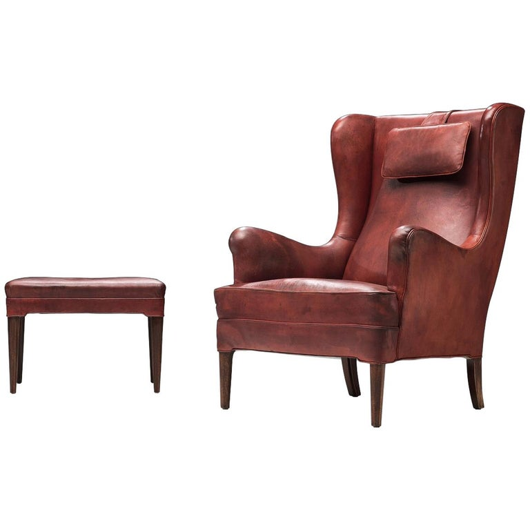 Frits Heningsen Lounge Chair with Ottoman in Original Burgundy Leather For Sale