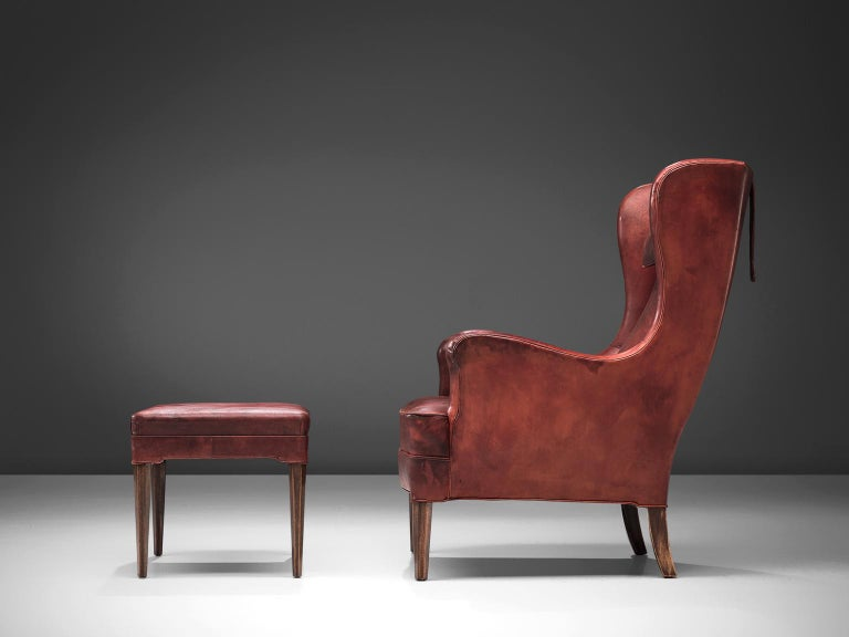 Mid-20th Century Frits Heningsen Lounge Chair with Ottoman in Original Burgundy Leather For Sale