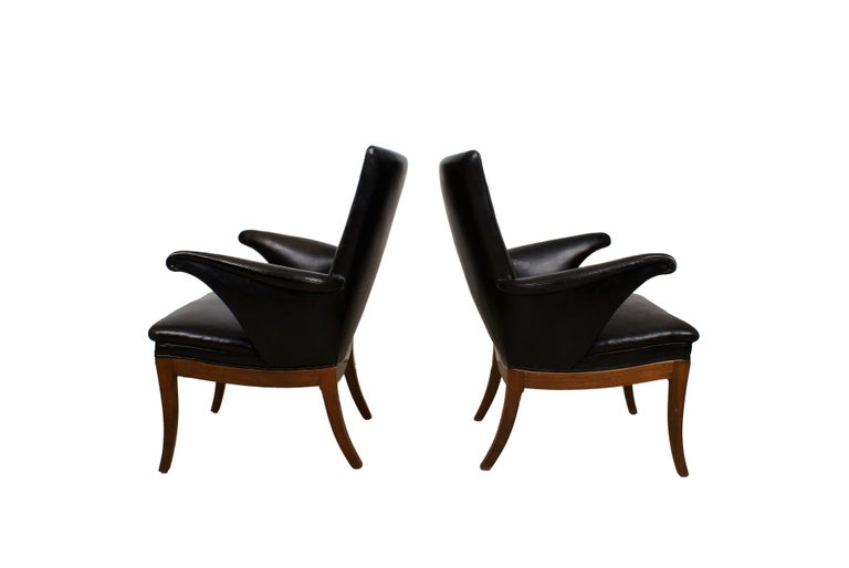 Frits Henningsen, pair of Cuban mahogany armchairs with curved armrests and legs. Sides, seat and back upholstered with patinated original black leather, fitted with brass nails. Back with leather covered buttons. Designed 1932. Made by cabinetmaker