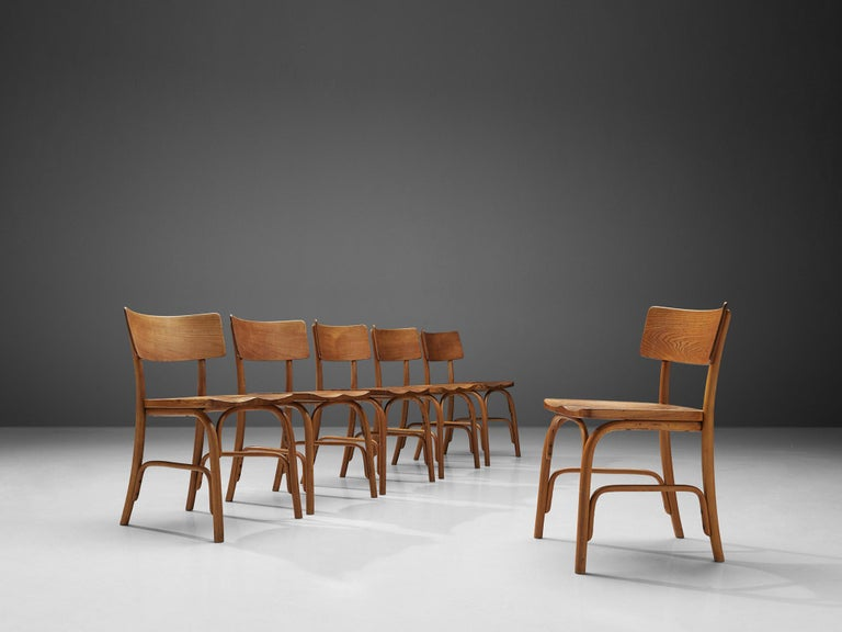 Frits Schlegel for Fritz Hansen, set of six 'Husum' chairs, elm,Denmark, 1930  Danish designer Frits Schlegel created the 'Husum' chair which got manufactured by Fritz Hansen in different editions. This model made out of beech features a