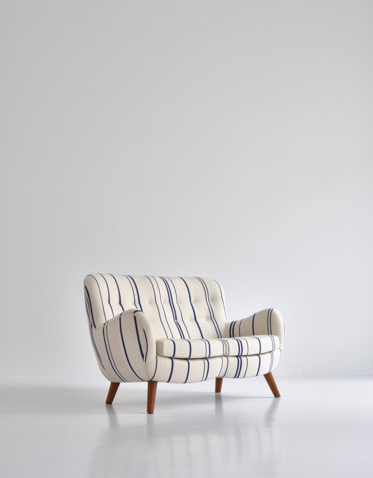 Rare and important sculptural sofa attributed to Frits Schlegel, made in Denmark in the 1940s. Completely refinished and reupholstered in exclusive blue / off-white striped high-quality Savak wool fabric.