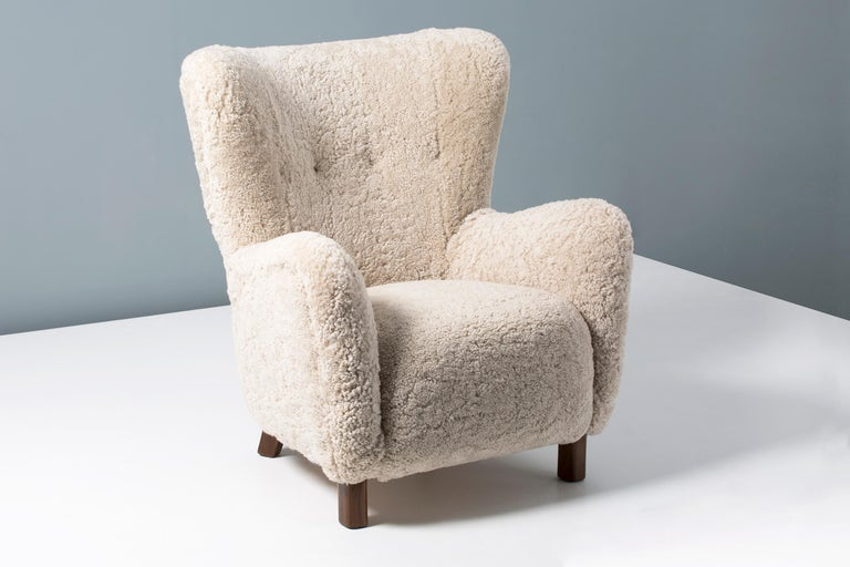 Rarely seen model 1664 lounge chair produced by Fritz Hansen in Denmark, in the 1940s-1950s. This model is similar to the iconic 1669 armchair and has a slightly higher back. The legs are stained beechwood and the chair has been completely