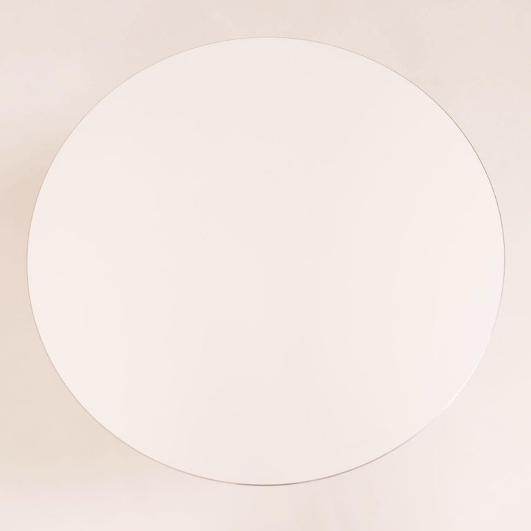 Originally designed in 1968 by Piet Hein, Bruno Mathsson and Arne Jacobsen, the A622 table is manufactured by Fritz Hansen in Denmark.  The modern contemporary round table features a circular white laminate top with an aluminium edge, sitting on a