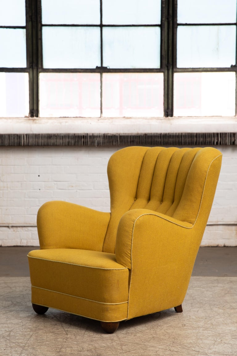 Sublime highback lounge chair with channeled back made in Denmark in the late 1930s or early 1940s. This model chair is seen from time to time in the Danish market and is often attributed to Fritz Hansen, but unfortunately the Fritz Hansen