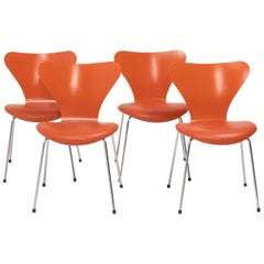 Fritz Hansen by Arne Jacobsen Orange Leather Series 7 Chairs, Set of 4