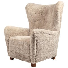 Fritz Hansen, Large High Back Wing Chair in Shearling and Oak, Denmark, 1940s