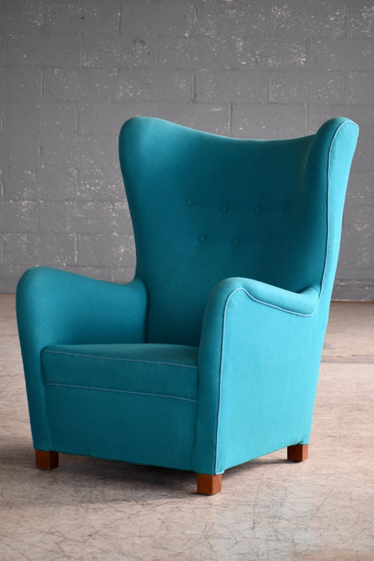 Sought after Fritz Hansen Model 1672 high back lounge chair made circa 1942. The Model 1672 chair was first seen on page 12 in Fritz Hansen's 1942 catalog. The chair has since become of the most sought after and iconic high back chairs to come out