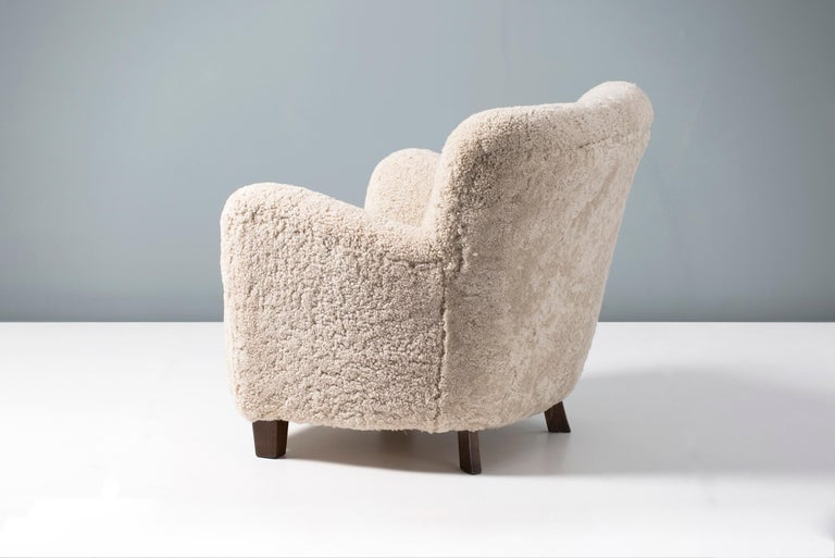 Lounge chair produced in Denmark, in the 1950s and attributed to Fritz Hansen. The legs are stained beechwood and the chair has been completely reconditioned in our London workshop with new upholstery in luxurious Australian shearling. The springs