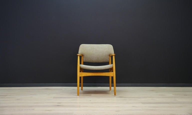Original 1960s-1970s armchair, Minimalist form, Scandinavian design. Manufactured in the Fritz Hansen manufacture. Original upholstery (color - gray), construction and backs made of oak. Preserved in good condition (minor scratches on wooden