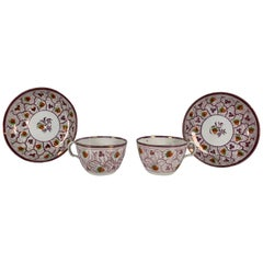 From the Collection of Mario Buatta a Pair of Pink Lustre Cups and Saucers