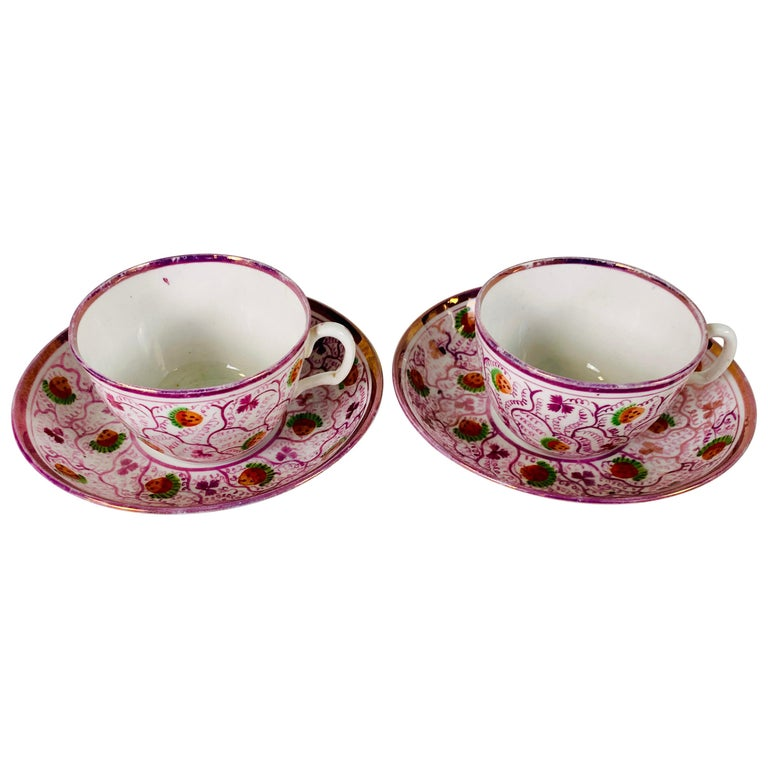 From the Collection of Mario Buatta a Pair of Pink Luster Teacups For Sale