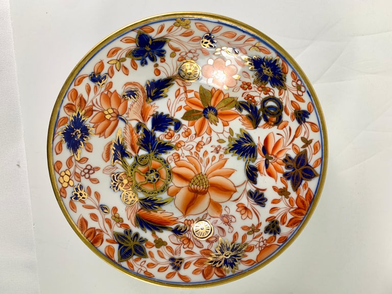 Provenance: The Private Collection of Mario Buatta  Mario loved beautiful combinations of colors. This set of four English Tobacco Leaf pattern saucers have Imari colors which are exquisite. The saucers have a vivid palette of orange red, cobalt