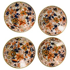 From the Collection of Mario Buatta a Set of Four Imari Tobacco Leaf Saucers