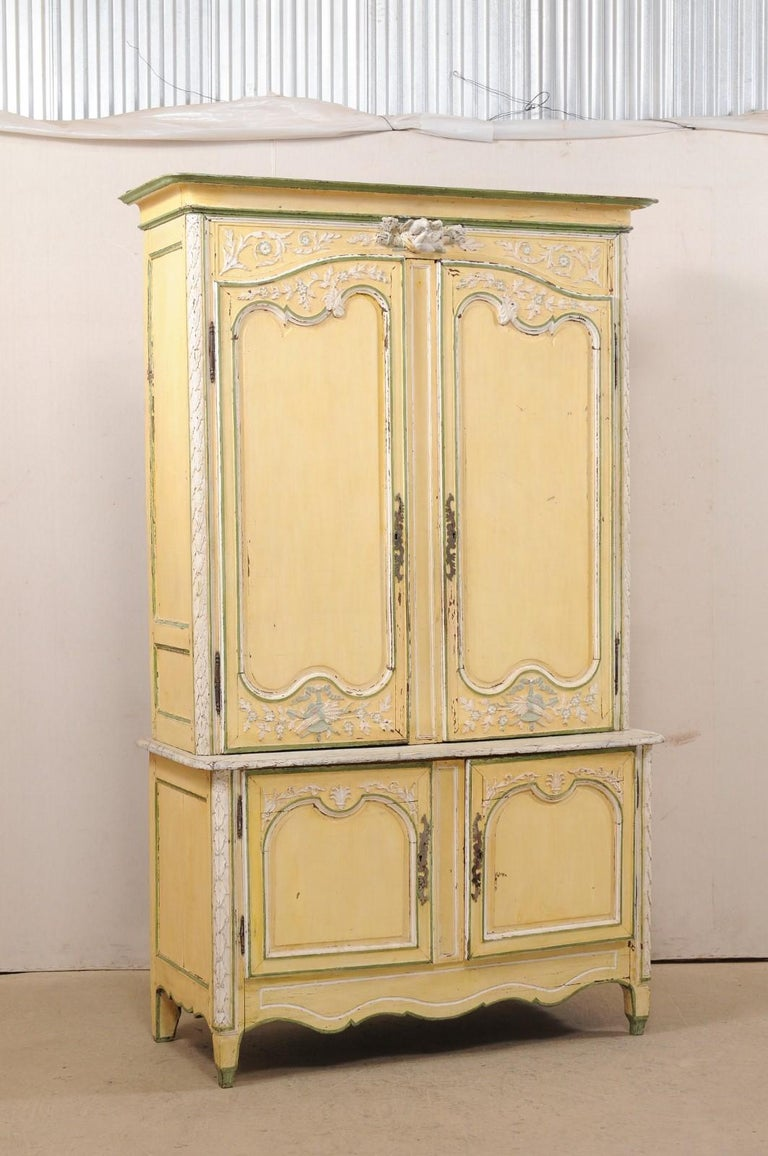 A lovely antique buffet à Deux-corps cabinet from the estate of Jacqueline Lee