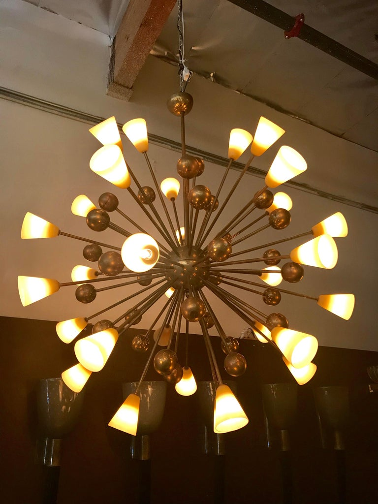 Vintage Italian chandelier with hand blown frosted amber Murano glass shades and decorative brass spheres, mounted on brass frame / Made in Italy circa 1960's 30 lights / E12 type / max 40W each Diameter: 44 inches / Height: 55 inches including rod