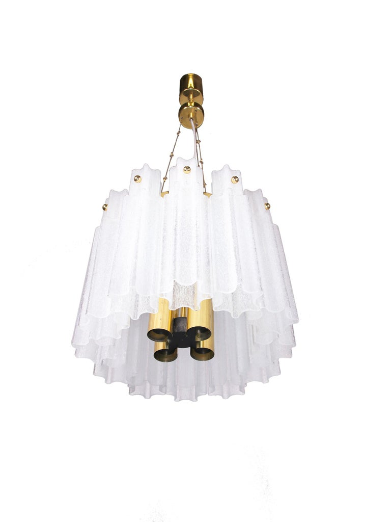 Amazing chandelier made of brass with frosted glass cylinders. Made in the 1960s by Glashuette Limburg, Germany. Meaurements: diameter 35 cm / 13.8 in., height 30,5 cm, 12 in., ceiling height including suspension 91 cm / 35.8 in. The lamp takes