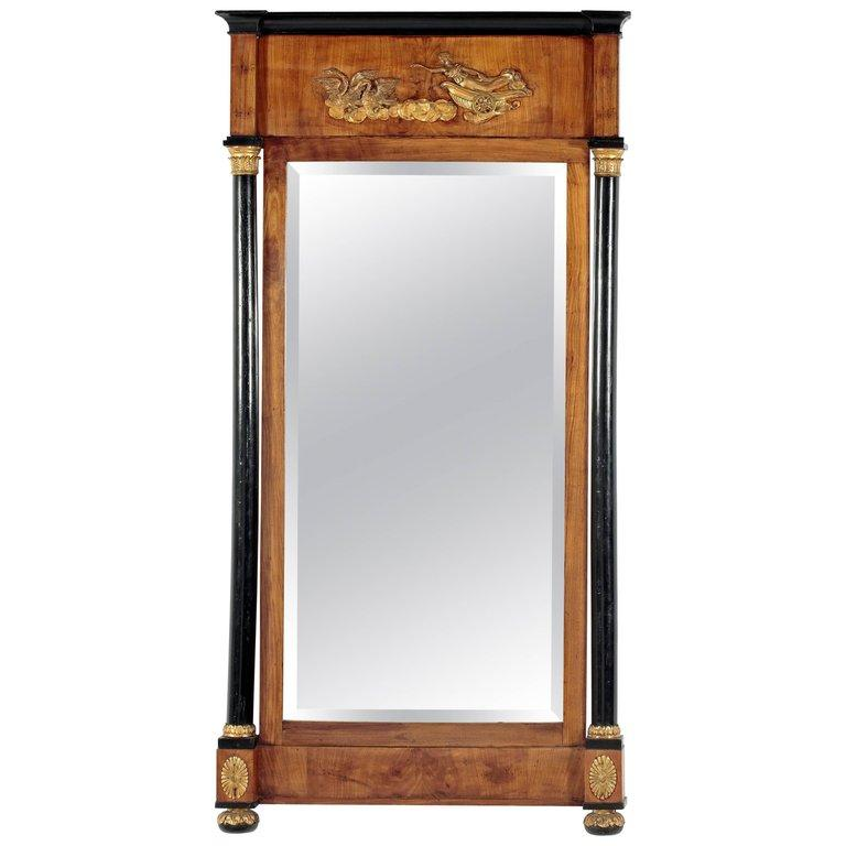 German Fruitwood and Ebonized Parcel Gilt Neoclassical Pier Mirror For Sale