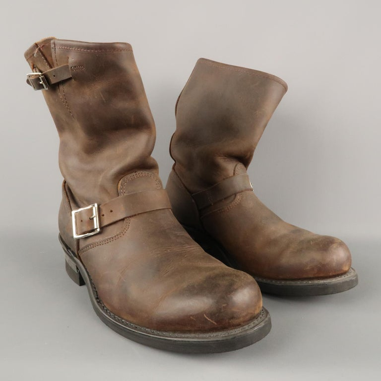FRYE Biker Boots comes in a brown tone in a solid leather material, with a round toe, a double buckle and straps, in an