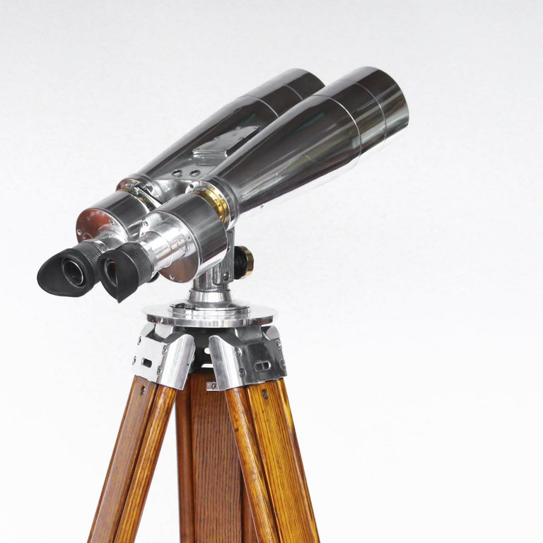 A pair of Fuji Meibo 15x80 marine binoculars on later extending wood and chrome stand with chromed conical feet. 15x magnification with 80mm objective lens.